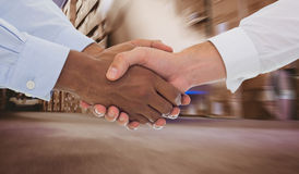 Composite image of close-up shot of a handshake in office Stock Photos