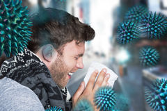 Composite image of close up side view of man blowing nose Royalty Free Stock Image