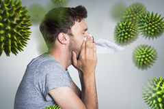 Composite image of close up side view of man blowing nose. Close up side view of man blowing nose against grey vignette stock photos