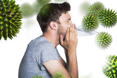 Composite image of close up side view of man blowing nose. Close up side view of man blowing nose against virus royalty free stock photography