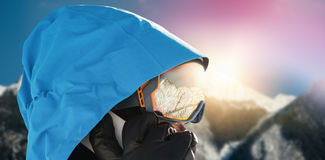 Composite image of close-up of skier talking on mobile phone Stock Images