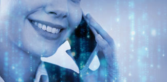 Composite image of close up of smiling businesswoman talking on mobile phone Royalty Free Stock Photo