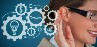Composite image of close up of smiling businesswoman trying to listen Royalty Free Stock Images