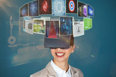 Composite image of close up of smiling businesswoman wearing virtual video glasses 3d Royalty Free Stock Photos