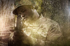 Composite image of close up of soldier aiming with rifle. Close up of soldier aiming with rifle against footbridge over stream in forest royalty free stock photos