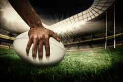 Composite image of close-up of sports player holding ball Stock Photo