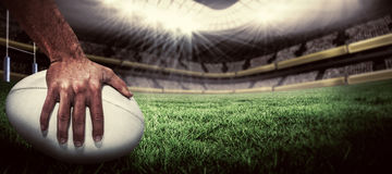 Composite image of close-up of sports player holding ball Stock Photos