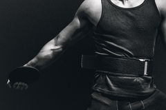 Composite image of close up on sportsman chest practising discus throw Royalty Free Stock Image