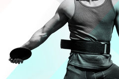 Composite image of close up on sportsman chest practising discus throw Royalty Free Stock Images