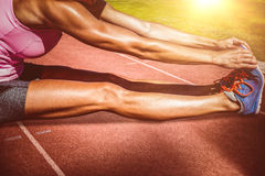 Composite image of close up of sportswoman stretching her muscles Royalty Free Stock Image
