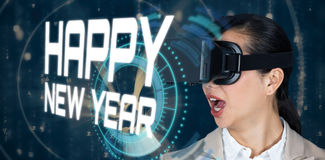 Composite image of close up of surprised businesswoman wearing virtual video glasses Stock Photos