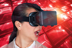 Composite image of close up of surprised businesswoman wearing virtual video glasses Royalty Free Stock Photography