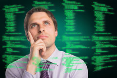 Composite image of close-up of thoughtful businessman looking up Stock Images
