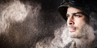 Composite image of close up of thoughtful military soldier. Close up of thoughtful military soldier against black stock images