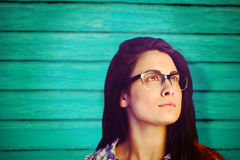 Composite image of close up of thoughtful woman wearing eyeglasses Stock Image