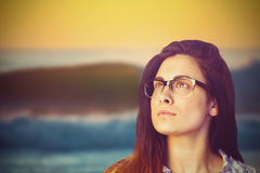 Composite image of close up of thoughtful woman wearing eyeglasses Stock Photography
