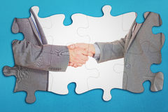 Composite image of close up on two businesspeople shaking hands Stock Photography