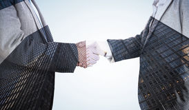 Composite image of close up on two businesspeople shaking hands Royalty Free Stock Images