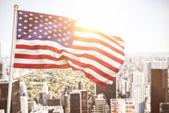 Composite image of close up of the us flag. Close up of the us flag against aerial view of new york royalty free stock images