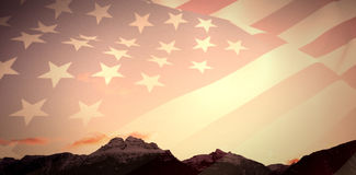 Composite image of close up of the us flag. Close up of the us flag against snowcapped mountains against sky Stock Photography