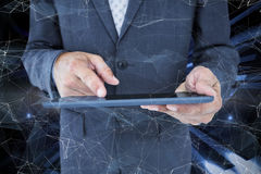 Composite image of  close up view of businessman using tablet computer Stock Photos