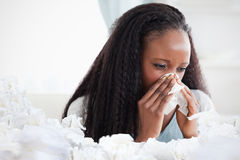Composite image of close up of woman blowing her nose Stock Photography