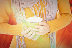 Composite image of close up of woman drinking from a cup. Close up of woman drinking from a cup against autumn scene Stock Images