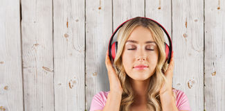 Composite image of close up of a woman listening to music Stock Photography