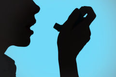 Composite image of close up of a woman using an asthma inhaler Royalty Free Stock Photos