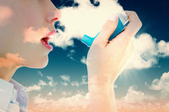 Composite image of close up of a woman using an asthma inhaler Royalty Free Stock Images