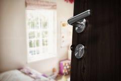 Composite image of closeup of brown door with doorknob Royalty Free Stock Photo