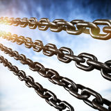 Composite image of closeup 3d image of silver chains. Closeup 3d image of silver chains against view of cloudy sky Stock Photography