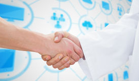 Composite image of closeup of a doctor and patient shaking hands Royalty Free Stock Image