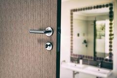 Composite image of closeup of door with doorknob and key Stock Photo