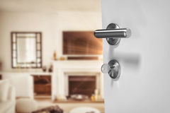 Composite image of closeup of doorknob and lock with key Royalty Free Stock Image