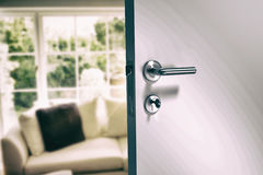 Composite image of closeup of metal doorknob and lock with key Royalty Free Stock Photo