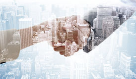 Composite image of closeup of shaking hands after business meeting Stock Photos
