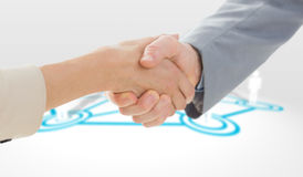 Composite image of closeup of shaking hands after business meeting Royalty Free Stock Photography