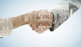 Composite image of closeup of shaking hands after business meeting Stock Images