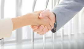 Composite image of closeup of shaking hands after business meeting Royalty Free Stock Image