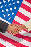 Composite image of closeup of shaking hands over eye glasses and diary Royalty Free Stock Images