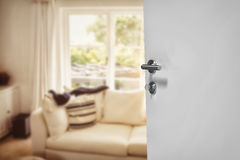 Composite image of closeup of white door with metal doorknob and lock Royalty Free Stock Images
