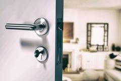 Composite image of closeup of wooden door with metallic doorknob Stock Image