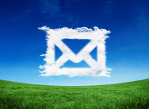 Composite image of cloud email. Cloud email against green field under blue sky Royalty Free Stock Photography