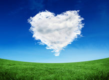 Composite image of cloud heart. Cloud heart against green field under blue sky Royalty Free Stock Image