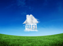 Composite image of cloud house. Cloud house against green field under blue sky Royalty Free Stock Image