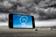 Composite image of cloud light bulb on smartphone screen Stock Photos