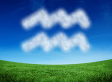 Composite image of cloud in shape of aquarius star sign Stock Image