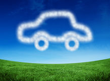 Composite image of cloud in shape of car. Cloud in shape of car against green field under blue sky Stock Photography