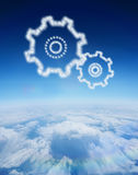 Composite image of cloud in shape of cogs and wheels Royalty Free Stock Images